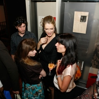Tara Moss chatting with visitors to the Femme Fatale exhibition at the launch