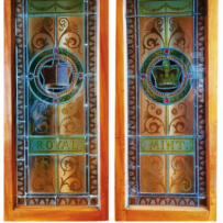 The colourful stained glass entry doors at The Mint, featuring a crown in the centre with the words 'Royal Mint'