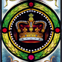Image of the beautifully coloured stained glass entry doors, it features a crown surrounded by a green wreath and some floral desings.