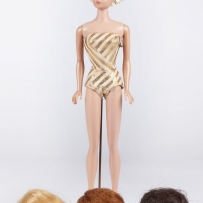 60s Barbie with array of wigs
