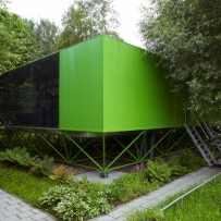 Front view of prefabricated, bright green, house in the Netherlands