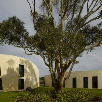 Exterior of curved modern house in Flinders, Victoria, Australia