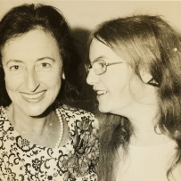 Two women, one facing camera (left), the other side on (right).