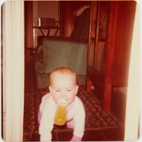 Crawling baby in doorway.