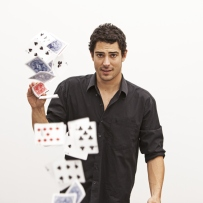 Man doing magic trick with cards.