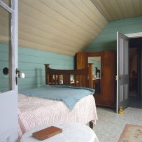 Upstairs bedroom, a bed is visible to the left