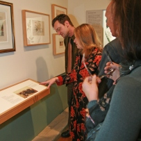 Colleen Morris shows guests through the exhibition