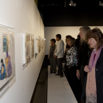Guests looking at artworks in Theme Gallery exhibition space