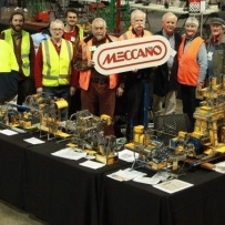 A group of people and their meccano sets