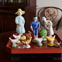 Figurines on wooden table.