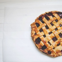 Image of a pie with lattice work pastry top