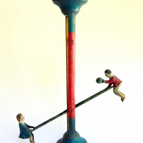 An old tin see saw toy