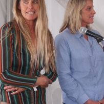 Two women on stage.
