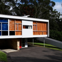 Modernist house in bushland setting.