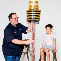 LEGO builder Ryan McNaught and boy next to the Sydney Tower model.