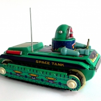 A green tin space tank with astronaut driver