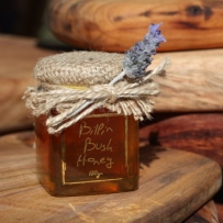 Jar of honey with timber boards