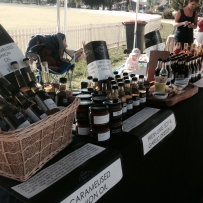 Market stall displaying bottles and jars of produce