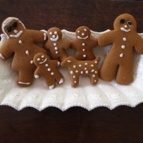 Six finished gingerbread shapes, including people and a dog.