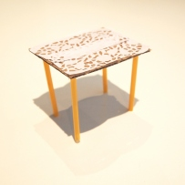 Small table made from paper, straws and cardboard.