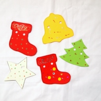 Five shapes in white, red, yellow and green with glued decorations.