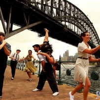 People dancing under the Sydney Harbour Bridge