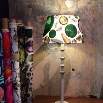 Vintage painted table lamp with custom-made Swedish linen lampshade + rolls of printed Swedish linens.