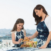 Woman and girl in aprons