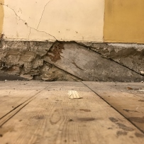 Timber rafter embedded in west wall