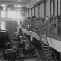 Rows of machines and stairs to mezzanine.