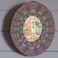 Round painted timber frame with an animated image in the centre