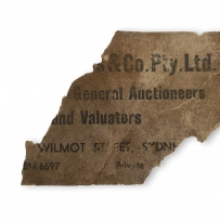 Piece of torn card with some print still visible.