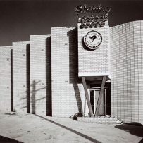 Black and white photograph of a factory.