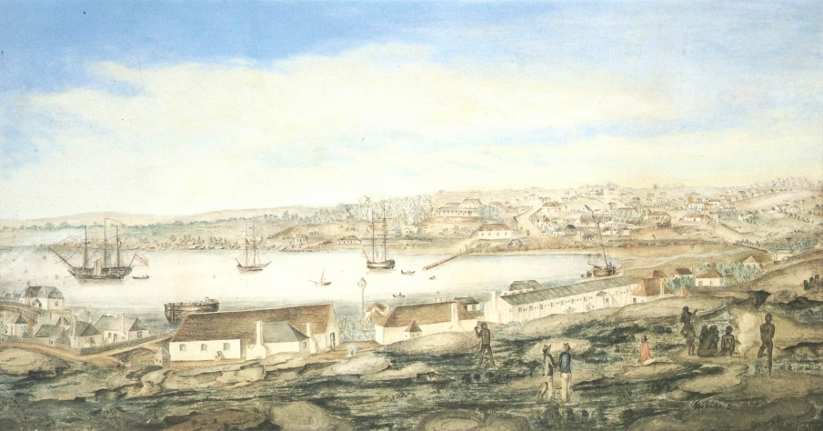 View looking across Sydney Cove from the rocks. A group of convicts and Aboriginal people gather in the foreground.