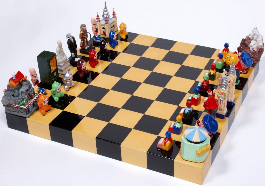 Chess set on board. Pieces based on Luna Park icons.