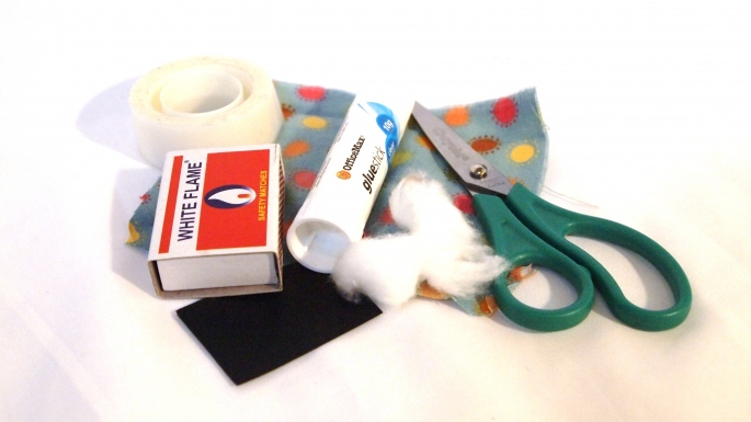 What you will need: An empty matchbox, cotton wool, cardboard, lead pencil, fabric, glue or sticky tape