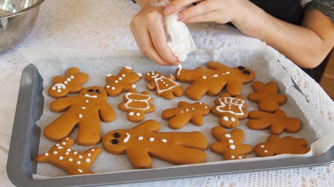Gingerbread shapes being decorated.