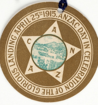 Circular badge with 5 pointed star motif with letters ANZAC on each point.