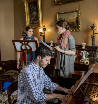 Nathan Cox (piano), Johanna Knoechel (singer) and Nyssa Milligan (singer) from the Historical Performance Unit, Sydney Conservatorium of Music, in the drawing room at Elizabeth Bay House
