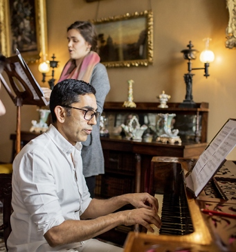 Performing music in the drawing room at Elizabeth Bay House