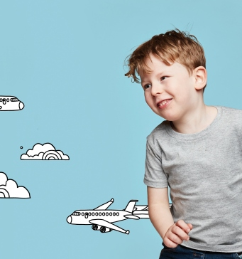 Boy with illustrated plane flying past