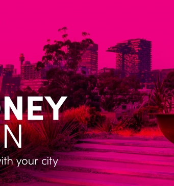 Pink tinted image of the Sydney skyline from a roof top. The words 'Sydney Open: reconnect with your city 6-8 November' sit on top.