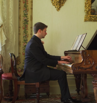 Man playing piano at Vaucluse House