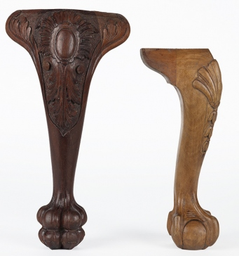 Two carved timber furniture legs