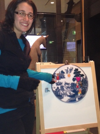 A staff member tells the story of the Willow Pattern