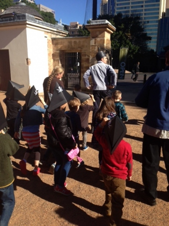Children stride across the courtyard to find the treasure