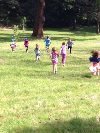 Kids running as they explore the paddock