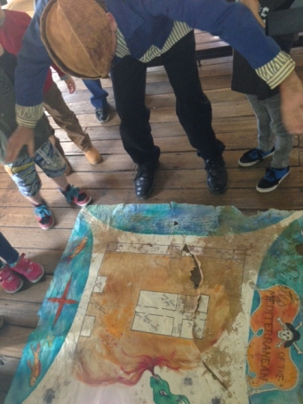 Reading the map to find the treasure.