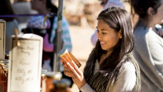 Sukritta shopping at the Bilpin Bush Honey stall at the Autumn Harvest Market