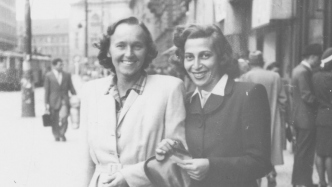 Black and white photograph of two women in winter coats.